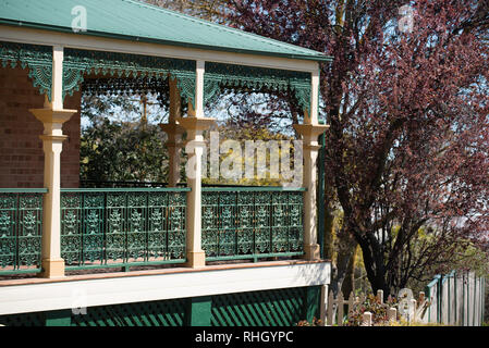 Iron lacework and a corrugated steel roof of a Federation filigree style home in Millthorpe, New South Wales, Australia - Stock Image