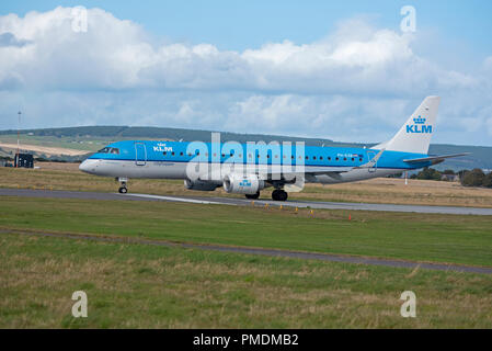 KLM City Hopper from Amsterdam at Inverness airport on it's daily scheduled trip over the North Sea. - Stock Image