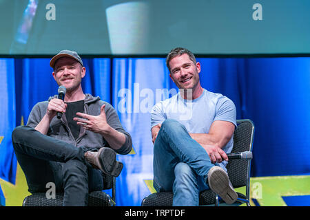 Bonn, Germany - June 8 2019: Luke Macfarlane and Aaron Ashmore talk about their experiences in Killjoys at FedCon 28, a four day sci-fi convention. FedCon 28 took place Jun 7-10 2019. - Stock Image