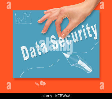 A hand picking up a Data Security concept on a colorful drawing board. - Stock Image