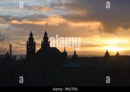 Kelvingrove, Glasgow, Scotland, UK, Europe. weather.19th Dec, 2018.   View of the Glasgow museum and Art Gallery towers and turrets silhouetted against the orange sky and setting sun. - Stock Image
