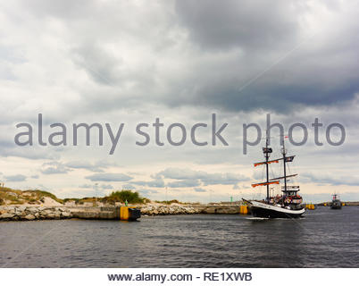 Kolobrzeg, Poland - August 10, 2018: Santa Maria pirate excursion sail ship on water by the port in the seaside on a cloudy day - Stock Image