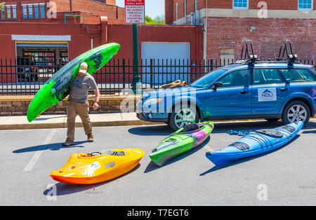 JOHNSON CITY, TN, USA-4/27/19: A selection of kayaks on display at a Saturday farmers' market in Johnson City. - Stock Image