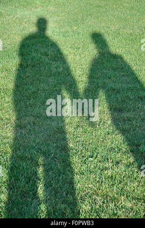shadow of couple holding hands, UK - Stock Image