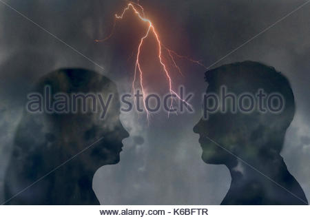 Forked lightning between couple looking at each other face to face - Stock Image