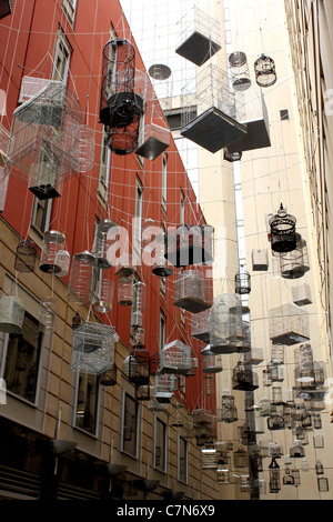 Lots of empty bird cages hanging in the city - Stock Image
