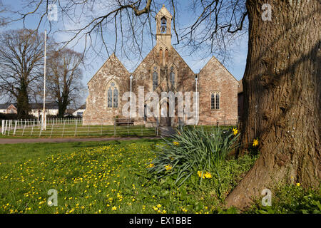 St Peter's Church of England church in Williton during springtime. - Stock Image