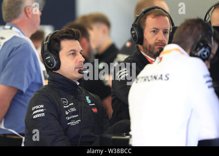 Silverstone Circuit. Northampton, UK. 13th July, 2019. FIA Formula 1 Grand Prix of Britain, Qualification Day; Toto Wolff watches proceedings in the garage area Credit: Action Plus Sports/Alamy Live News - Stock Image