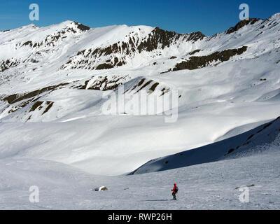 Descending from Col de Longet, Parc regional du Queyras, French Alps on snowshoes - Stock Image