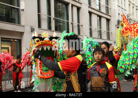 London, UK. 1st January, 2019. Performers from the london Chinatown CHinese Association seen ahead of the New Years parde at Berkley Square. About 8,000 performers representing the London boroughs and over 20 countries from across the globe take part on the annual New Years Parade on the street of London. . The parade run from Green Park Tube station to Parliament Square. Photo credit:  David Mbiyu/Alamy New Live - Stock Image