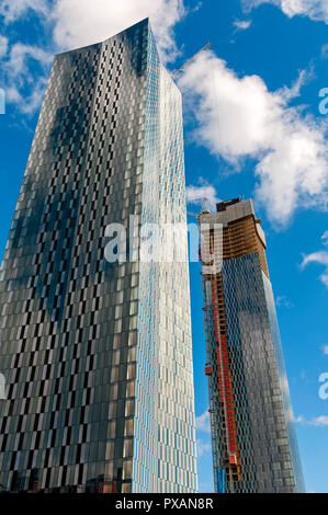 Two of the four Deansgate Square apartment blocks under construction (Aug 18).  Manchester, England, UK. - Stock Image