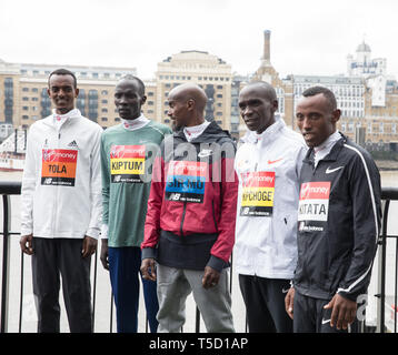 London, UK. 24th Apr, 2019. The London Marathon Elite Mens Photocall takes place outside the Tower Hotel with Tower Bridge in the background ahead of the Marathon on Sunday. Taking part are: Sir Mo Farah(GB), Eliud Kipchoge(Ken), Abraham Kiptum(Ken), Shura Kitata(ETH) and Tamirat Tola(ETH). Credit: Keith Larby/Alamy Live News - Stock Image