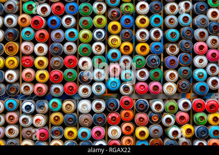 Collection of valve cups from multiple aerosol paint cans in the Tophane District of Istanbul, Turkey - Stock Image