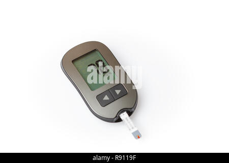 Danger of hypoglycemia, glucometer with low blood sugar isolated on white background - Stock Image