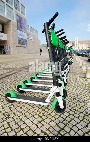 Lime Lime-S dockless electric scooters for hire in Lisbon, Portugal - Stock Image