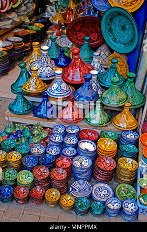 A display of traditioal decorated pottery In the Souk the Street Market at Jemaa el Fnaa in the Medina Old City in the centre of Marrakech in Morocco. - Stock Image