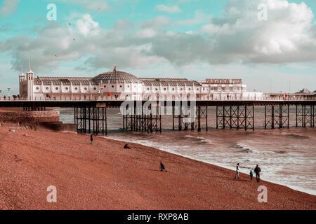 Brighton pier, Sussex, UK (orange & teal cinematic-style toning) - Stock Image