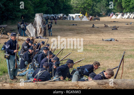Duncan Mills, CA - July 14, 2018: Union army firing guns at the Northern California's Civil war reenactment. The Civil War Days is one of the largest  - Stock Image