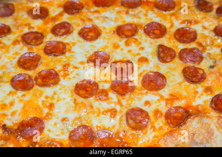 Close up picture of a pepperoni pizza - Stock Image