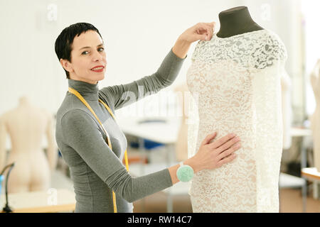 Sewing new dress - Stock Image