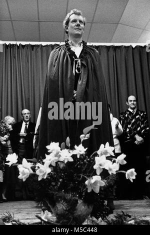 Chaired bard receiving prize on stage at small eisteddfod in village hall at Llandudoch St Dogmaels Dyfed West Wales - Stock Image