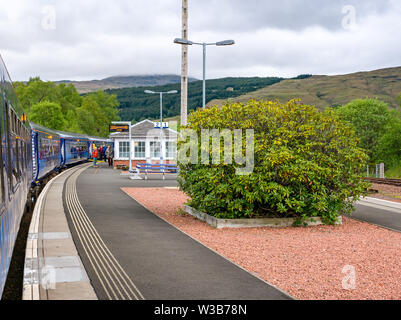 Crianlarich rural train station platform with ScotRail train on West Highland railway line, Stirlingshire, Scotland, UK - Stock Image