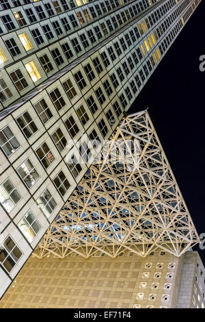 Evening view of Southeast Financial Center towers and suspended glass structure above plaza, SE 2nd Street, Midtown - Stock Image