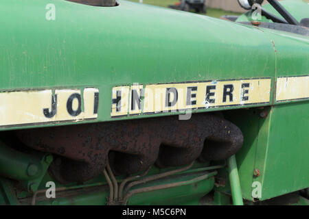 Closeup of John Deere Tractor with worn logo on side - Stock Image