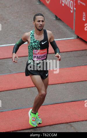 London, UK, 28 April 2019 Yassine Rachik of Italy.  Runners at finishing line of  Virgin London Marathon Credit: JOHNNY ARMSTEAD/Alamy Live News - Stock Image