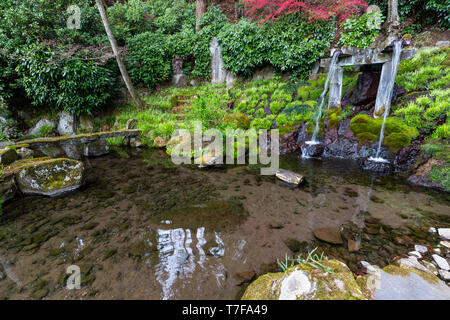 Jizo-ji Temple Garden Waterfall -Jizo-ji Temple Garden belongs to the Soto Zen sect of Buddhism. There is garden of kaiyu shiki teien style of the ear - Stock Image