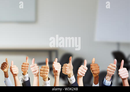 Hands in the conference room keep thumbs up - Stock Image