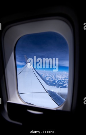 View of clouds through airplane window - Stock Image