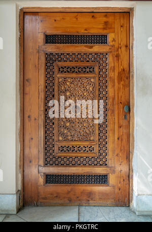 Wooden engraved door with geometrical engraved patterns, Cairo, Egypt - Stock Image