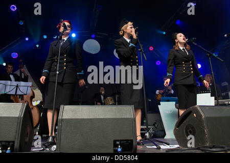 Portsmouth, UK. 25th Aug, 2013. Victorious Festival at Portsmouth Historic Dockyard.  The Three Belles, a 1940s - Stock Image
