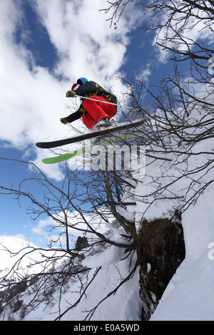 Mid adult man skier jumping on steep mountain, Mayrhofen, Tyrol, Austria - Stock Image