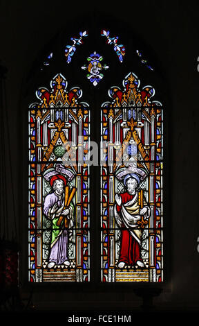 Stained glass window depicting Apostles St Andrew and St Peter, All Saints Church, Beighton, Norfolk - Stock Image
