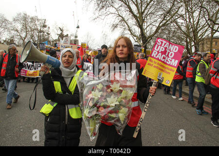 A steward holds a bouquet of flowers that were to be paid at the New Zealand high commission in honour of the 49 killed Muslims in the Christ Church  16 March. The demonstration which began in Park Lank and ended outside Downing Street was organised by Stand Up to Racism and Love Music Hate Racism and supported by the TUC and UNISON. Photo: David Mbiyu Credit: david mbiyu/Alamy Live News - Stock Image