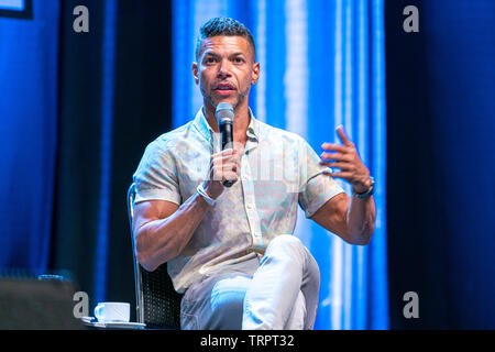 Bonn, Germany - June 8 2019: Wilson Cruz (*1973, American actor - Star Trek: Discovery) speaking at FedCon 28, a four day sci-fi convention. FedCon 28 took place Jun 7-10 2019. - Stock Image