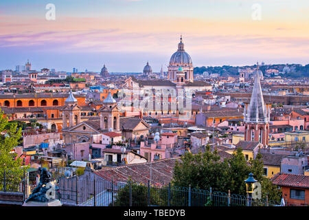 Rome rooftops and landmarks colorful sunset view, capital city of Italy - Stock Image