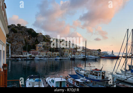 First morning light at harbor of Symi island - Stock Image
