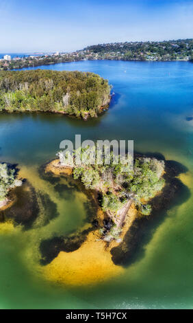 Narrabeen lake and lagoon on a sunny day in vertical aerial overhead panorama from water surface to distant plateau and pacific coast. - Stock Image