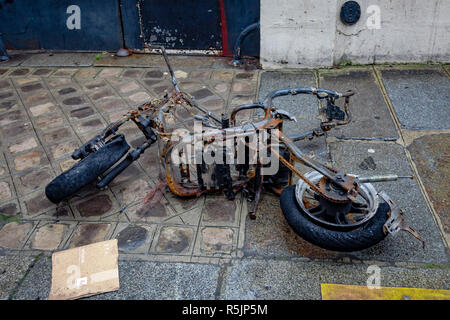 Paris, France. 1st December, 2018.  Destroyed motorbike during the Yellow Vests protest against Macron politic. Credit: Guillaume Louyot/Alamy Live News - Stock Image