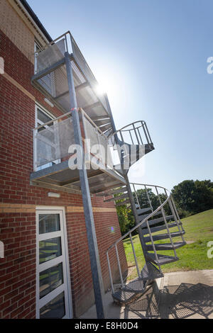 Exterior metal spiral fire escape staire to outside of building. - Stock Image