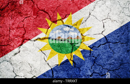 Yaracuy State flag, state of Venezuela, on dry earth ground texture background - Stock Image