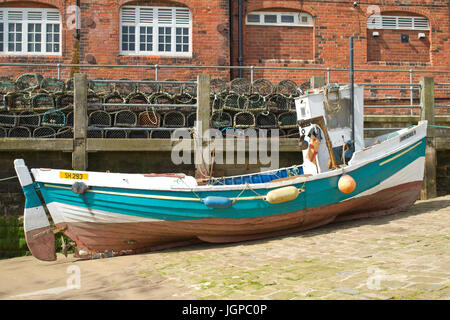 Small Fishing Boat In. Scarborough Harbour North Yorkshire UK - Stock Image