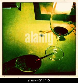 Wine glass shadow art - Stock Image