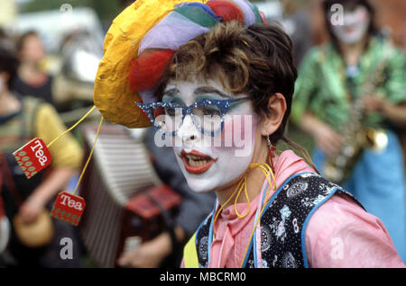 woman clown at a clown show in full make-up - Stock Image