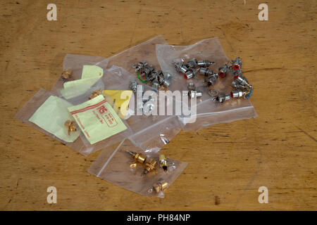 Assorted used/unused gold plated/plain phono sockets - Stock Image