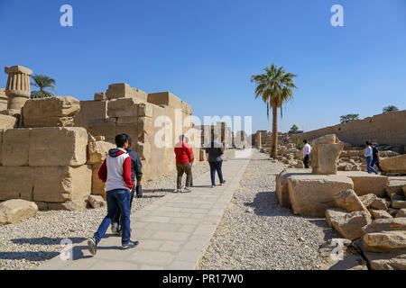 Tourists at The Karnak Temple Complex, also known as The Temple of Karnak, in Thebes, Luxor, Egypt - Stock Image
