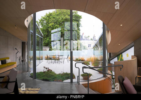 View looking out onto the rooftop garden from inside Maggies Centre at St Barts Hospital in Smithfield City of London UK  KATHY DEWITT - Stock Image